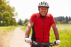 Man Riding Mountain Bike Along Path In Countryside royalty free stock photo