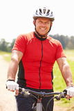 Man Riding Mountain Bike Along Path In Countryside Royalty Free Stock Photos