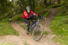 Man riding a mountain bike downhill style Royalty Free Stock Photos