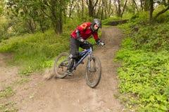 Man riding a mountain bike downhill style stock photography