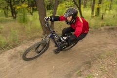 Man riding a mountain bike downhill style Stock Photos