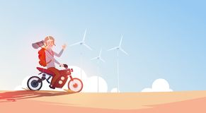 Man Riding Off Road Bike In Helmet Guy Travel On Motorcycle. Over Blue Sky With Wind Turbines Flat Vector Illustration Stock Photo