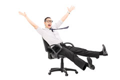 Man riding in an office chair and gesturing joy Royalty Free Stock Photos