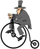 Man riding an old fashion bicycle. This illustration depicts a man in a top hat riding an old fashion big wheeled bicycle Stock Photo