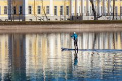 Man riding a paddle SUP royalty free stock images