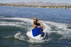 Man Riding PWC On Lake Stock Photos