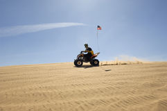 Man Riding Quad Bike In Desert Royalty Free Stock Photography