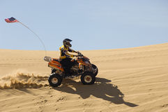 Man Riding Quad Bike In Desert Royalty Free Stock Photos