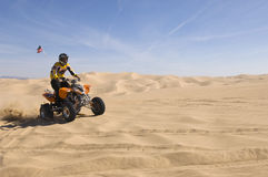 Man Riding Quad Bike In Desert Royalty Free Stock Images