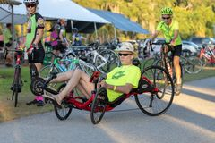 Man riding recumbent bike on the Withlacoochee State Trail. stock photos