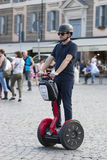 Man riding red segway Stock Image