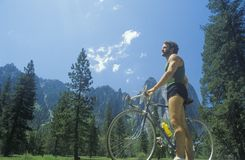 Man riding road bicycle Stock Images