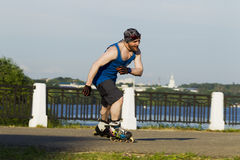 A man riding on roller skates in the city Royalty Free Stock Photos