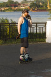 A man riding on roller skates talking on a mobile phone Stock Images