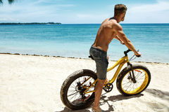 Man Riding Sand Bicycle On Beach. Summer Sport Activity Royalty Free Stock Image