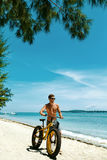 Man Riding Sand Bicycle On Beach. Summer Sport Activity Royalty Free Stock Photography