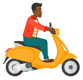 Man riding scooter. Royalty Free Stock Photos