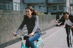 Man Riding in Scooter with Flowers for Attractive Woman on Bicyc Stock Photos