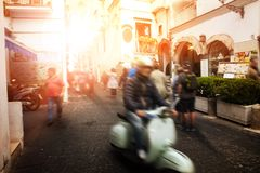Man riding scooter motorcycle in amalfi street south italy most. Popular traveling destination royalty free stock image