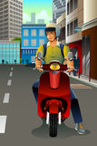 Man Riding a Scooter Stock Images