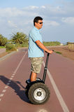 Man riding segway Royalty Free Stock Images
