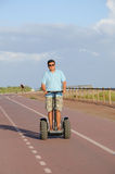 Man riding segway Stock Image