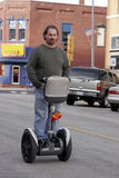 Man riding Segway. Man on personal transportation device Royalty Free Stock Photo