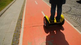 Man riding a segway, commuting to work, eco-friendly transport, modern vehicles stock video footage