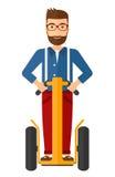 Man riding on segway Royalty Free Stock Image