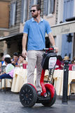 Man riding segway Stock Images