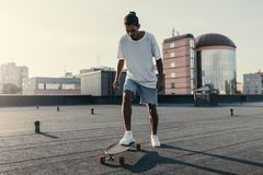 Man riding on skateboard on rooftop Royalty Free Stock Photo
