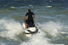 Man riding skijet. At the seaside Stock Photos