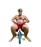 Man riding a small bicycle Royalty Free Stock Photo