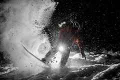 Man riding snowboard in the dark under the snow royalty free stock photo
