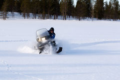 Man riding a snowmobile Royalty Free Stock Images