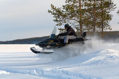 Man riding a snowmobile Stock Image