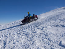 The man riding on the snowmobile. Stock Photo