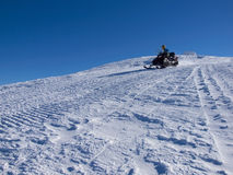 The man riding on the snowmobile. Royalty Free Stock Photo