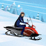 Man riding on a snowmobile Stock Photography