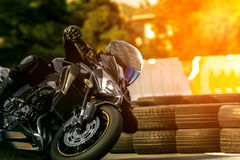 Man riding sport motorcycle on racing track Royalty Free Stock Images