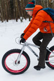 Man riding on sports bike. In winter wood Stock Image