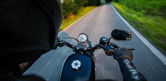 Man riding sportster motorcycle during sunset. Stock Photography