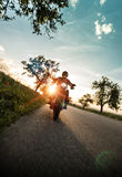 Man riding sportster motorcycle during sunset. Royalty Free Stock Photos