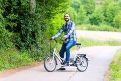Man riding tandem bike. On country lane Royalty Free Stock Photo