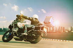 Man riding touring motorcycle on sharp curve for traveling and c Stock Images
