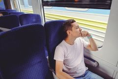 Man is riding a train, traveling by rail Royalty Free Stock Image