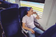 Man is riding a train, traveling by rail Royalty Free Stock Photo