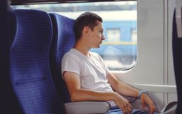 Man is riding a train, traveling by rail Royalty Free Stock Images