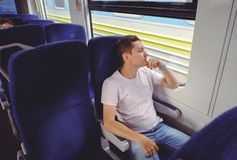 Man is riding a train, traveling by rail Royalty Free Stock Photos