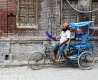 A man riding tricycle on street in Amritsar, India Royalty Free Stock Image